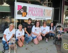 Passion 4 Paws volunteers (from left to right) Stephanie, Neville, Katie, Sage, Lauren, Heidi, Morgan, and Kaylee